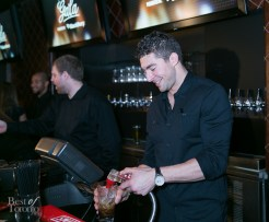 Joffrey Lupul serving beverages at Real Sports bar