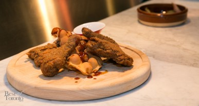 """General Sanders' Chicken"" with kung pao sauce, sichuan maple syrup, HK egg waffles"