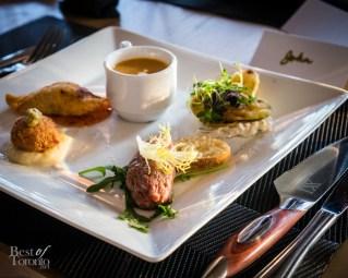 Crab cake, lobster potsticker, lobster bisque, eggplant & zucchini crisps, Paradise steak tartare