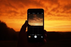 IPHONE AND SUNSET