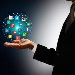 Businessman holding hologram with social media network icons