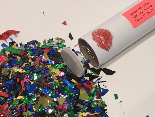 Spring-Loaded Glitter Bomb With a Sealed With a Kiss Sticker
