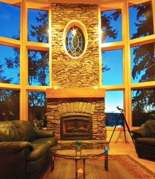 Photo of fireplace with lots of windows around