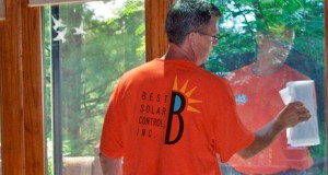 Ray Dison of Best Solar Control applies window film