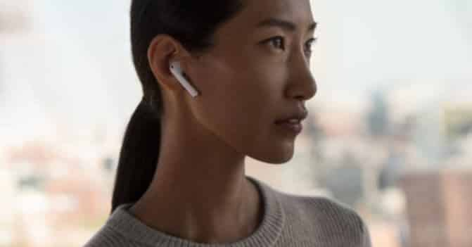 woman listening to music with airpods
