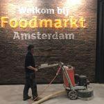 Opgeknapte betonvloer Foodmarkt Amsterdam