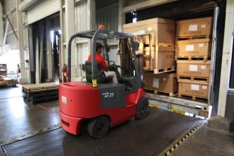 Forklift operator moving product