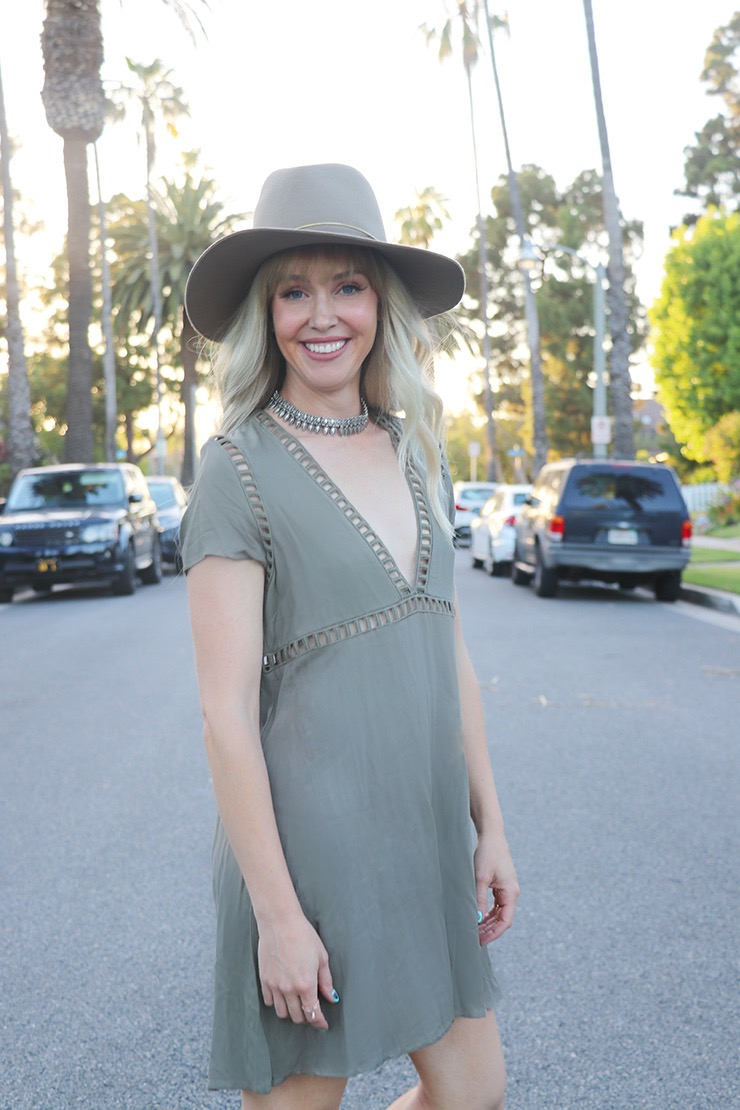 olive dress with tan hat