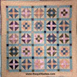 Churn Dash quilt from The Quilt Ladies