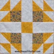 Simple quilt block of squares and triangles