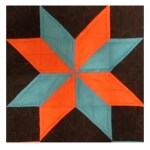 Orange and Blue Star Quilt Pattern using triangles
