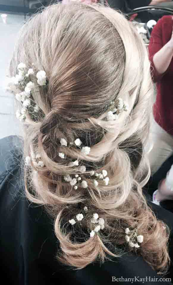 wedding hair style for long hair cascading curls and flowers