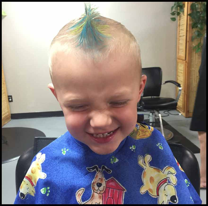 little boys hair cut faux hawk with green and yellow chalk color