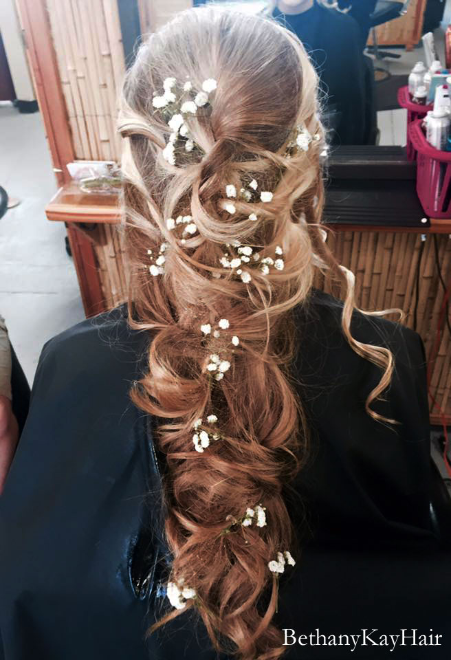 gorgeous wedding hair with cascading curls and flowers