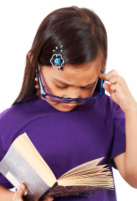 Young Girl Reading A Book And Having A Think About What It Says