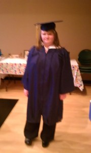 Leah Jones' graduation -in her blue cap, gown, and tassel