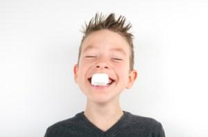 Boy eating marshmallow