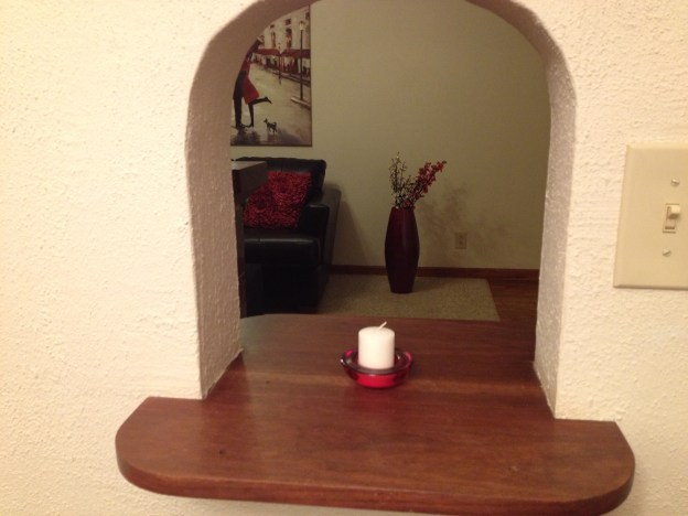 Red glass votive holder and candle