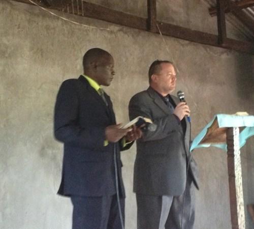Ray Jones, speaking, Bungoma, Kenya Pastor Patrick interpreting