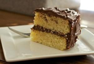 Yellow cake with chocolate frosting www.bakingthroughmsbh.files.wordpress.com-2010-03-slice1