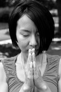 Asian woman praying