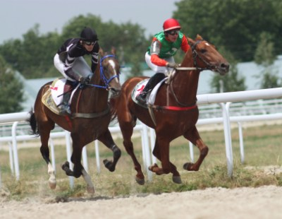 "PYATIGORSK, RUSSIA  - JULY 18: The race for the prize of the ""Asuan"";The jockey Hatkov and Smirnov. July 18; 2010 in Pyatigorsk; Caucasus; Russia."
