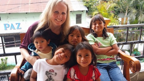 Guatamala missionary Rhonda Hedrick with the mom and the children she & Ron are taking into their home