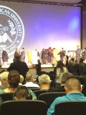 Heather crossing stage to get her degree