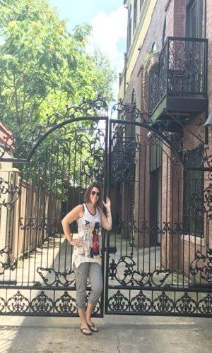 Heather by black iron gate