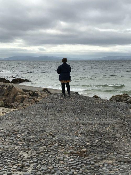A powerful pic: Leah looking at Atlantic Ocean in her raincoat
