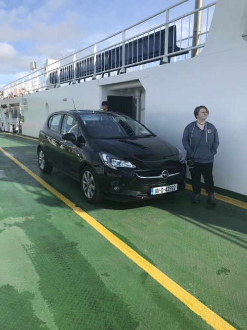 Our rental car and Leah on the ferry to Kerry