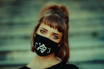 Young woman with mask. Image source: Unsplash