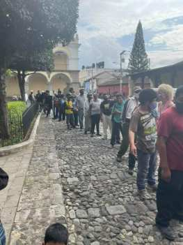 Indigenous people in line to get food and drink at Parque Central, Antigua