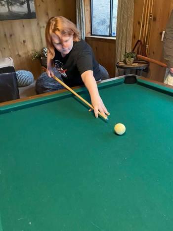 Leah playing pool
