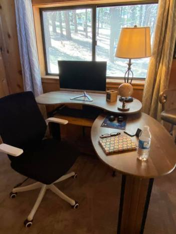 desk with computer and pens