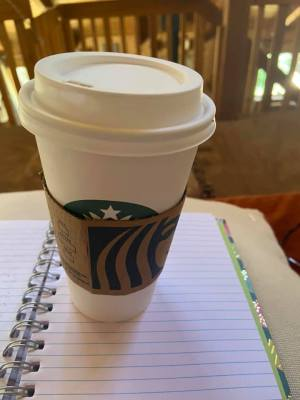 The Starbucks' hot caramel macchiato coffee Ray bought for me one afternoon to drink while journaling
