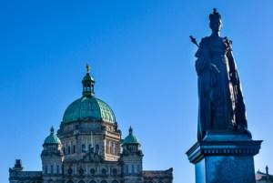 Provincial Capital Legislative Parliament Buildiing Queen Victoria Statue Victoria British Columbia Canada.  Gold Statue top of dome is of George Vancouver.