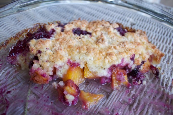 blueberry peach cobbler in the pan