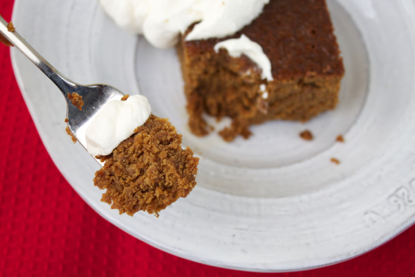 a bite of old-fashioned gingerbread with whipped cream