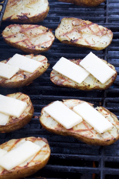 Crispy cheesy grilled potatoes are the ultimate summer side dish - plus, they're so easy!