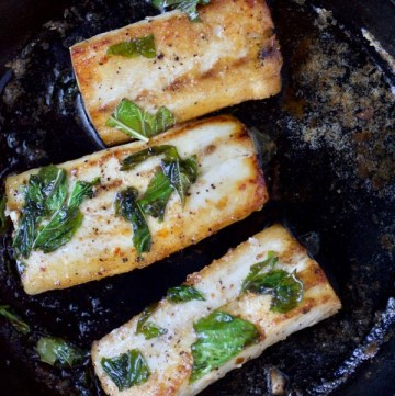 Pan-seared mahi-mahi with lime and basil in a cast iron skillet