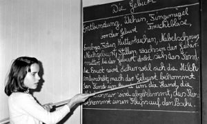 A primary schoolgirl at the blackboard in Hamburg, Germany, December 1968