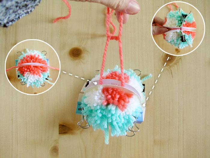 Tie yarn to the pompom