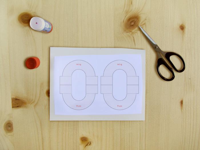 Pom pom template glued to cardstock