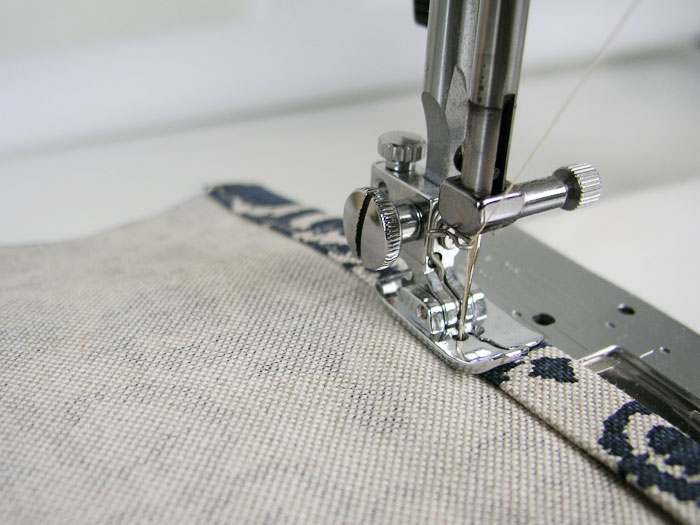 Sew edge stitching on the hems of the back pieces of the cushion