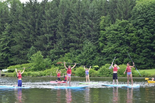 ymca camp soles people doing stand up paddleboarding