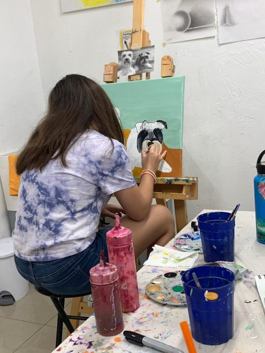 Girl painting dog