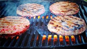 burger patties on grill