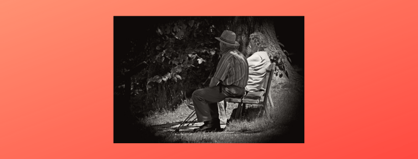 Photo of 2 people on a bench