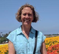 Photo of woman in flower field Ruth Struck